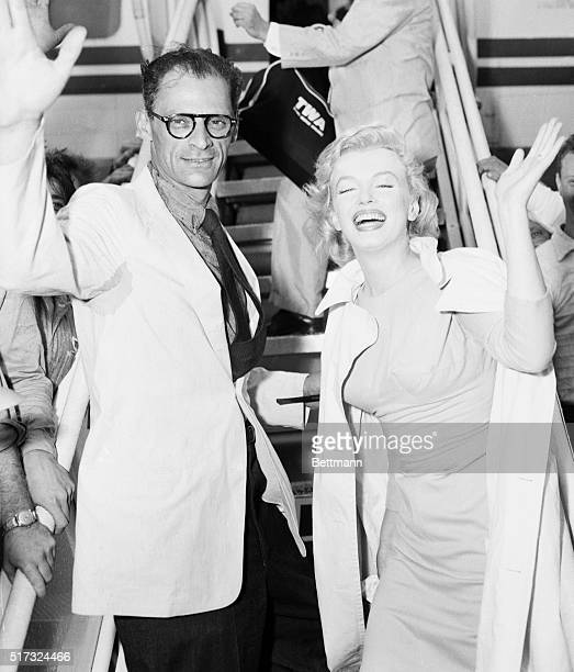 Idlewild Airport, New York: Marilyn Monroe and her new husband playwright Arthur Miller wave a cheery goodbye to newsmen before boarding a plane for...