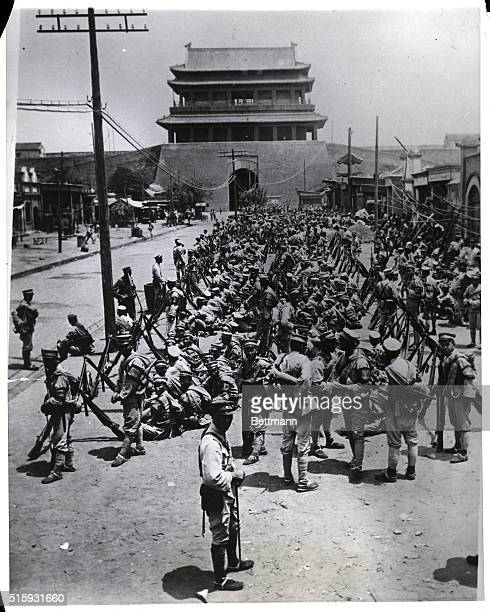 Peking, China: When the Nationalists entered Peking, it had been arranged through the diplomatic bodies that the 47th Manchurian brigade should stay...