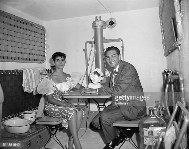 Setting up housekeeping in an underground bomb shelter newlyweds Melvin Minnison and Maria Rodiguez hold hands as they begin their twoweek honeymoon...