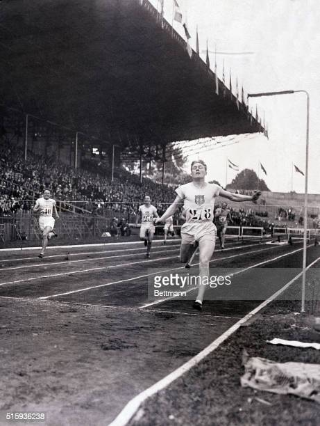 7/15/1924Paris France FM Taylor bearing the shield of the US wins the final 400meter hurdles and sets a new world record of 52 3/5 seconds