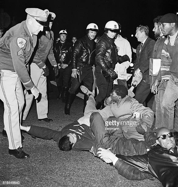 San Francisco, California- Police move in to arrest civil rights demonstrators who lay down and blocked a street leading from the Cow Palace at the...