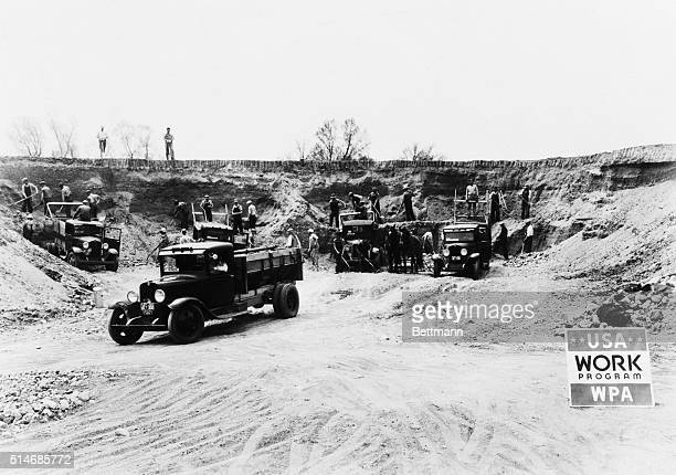 Union County, South Dakota: This photo shows farmers of Union County who were forced on relief by the drought, hauling gravel to be used in a WPA...