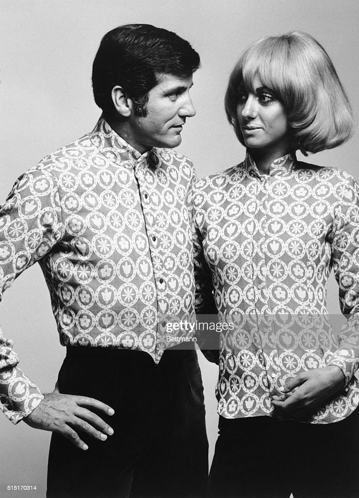 Man and Woman Posing In Unisex Shirts : News Photo