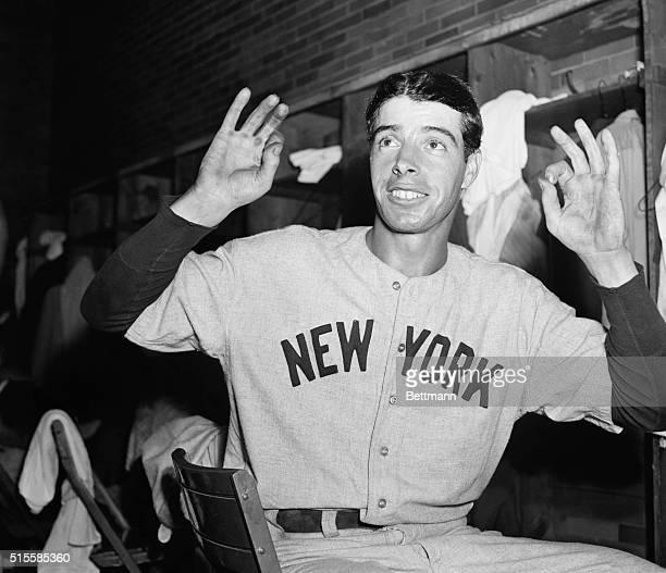 """Cleveland, OH: Joe DiMaggio, slugging outfielder of the New York Yankees, makes a pair of """"duck eggs"""" with his fingers to indicate that for the first..."""