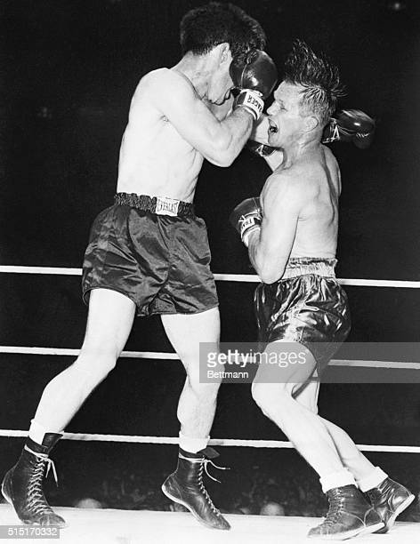 7/18/1947The beginning of the end Tony Zale defending middleweight Champion shakes and rocks as Rocky Graziano delivers a hard right to the face of...