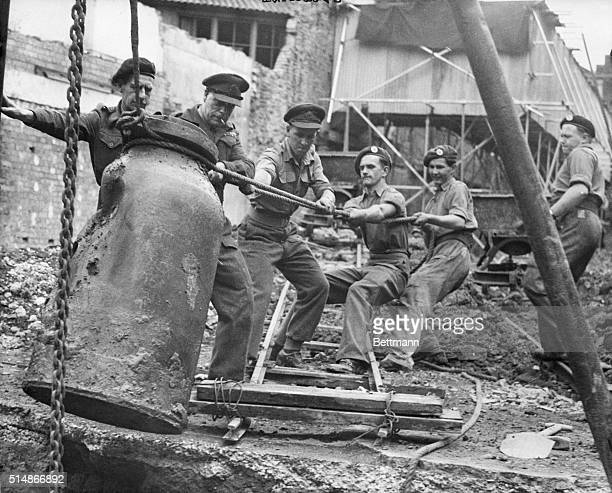 7/18/1949London England A bomb disposal squad headed by Major S F Knight is shown engaged in the ticklish job of removing a 2000pound German bomb...