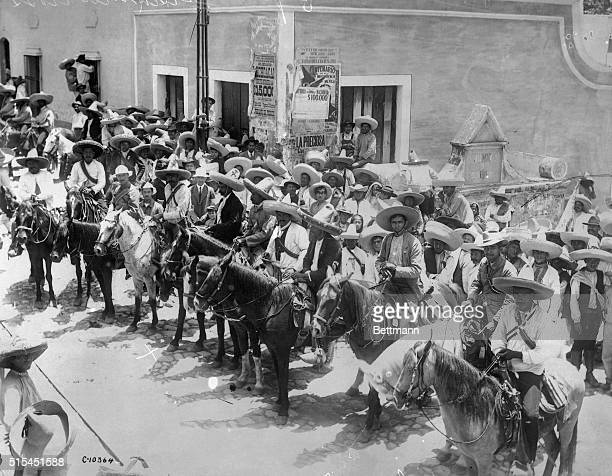 7/19/1915Mexico City MexicoEmiliano Zapata and his brother Eufemio Zapata head their personal body guard in the streets of Mexico City These men are...