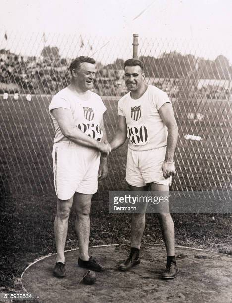 7/19/1924Paris France Matt Mac Grath poses with Fred Tootell winner of the hammer throw at Colombes Stadium