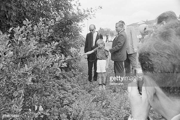 7/19/1965Kew Gardens Hills NY Ralph Warnecke points to the spot in the wooded area where out for a walk with his father Vernon he found the body of...