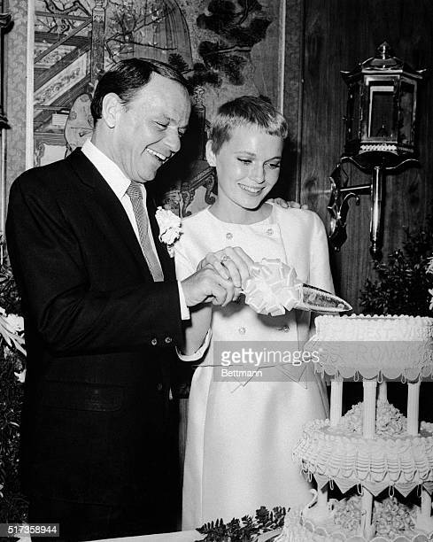 7/19/1966Las Vegas NV Happily cutting away at the wedding cake are newlyweds Frank Sinatra and Mia Farrow The couple was married at the Sands Hotel...