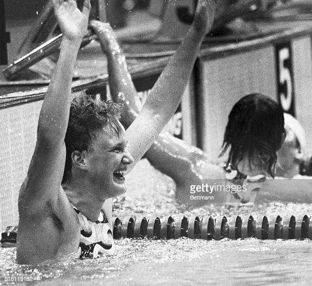 Montreal, Canada- Andrea Pollack of East Germany shows her joy as she waves after winning a gold medal, and setting a new Olympic record of 2:11;41...