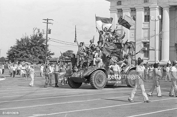 7/19/1979Managua NicaraguaVictorious Sandinista rebel forces completely cover a small minitank as they ride through the downtown streets singing and...