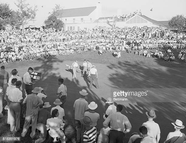 Fort Worth, TX- Dick Metz shakes hands with Craig Wood on the 18th green, after putting for a birdie in the National Open at Fort Worth.