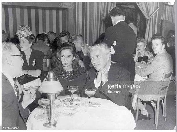 7/1943Comedic actor Charlie Chaplin and wife Oona O'Neill are shown seated at a table at Club Mocambo