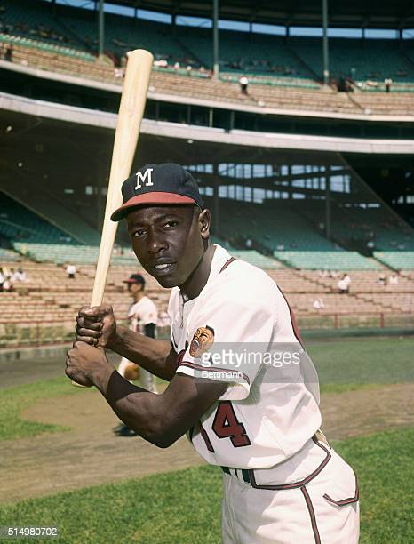 Hank Aaron in a batting pose wearing a Milwaukee Braves uniform