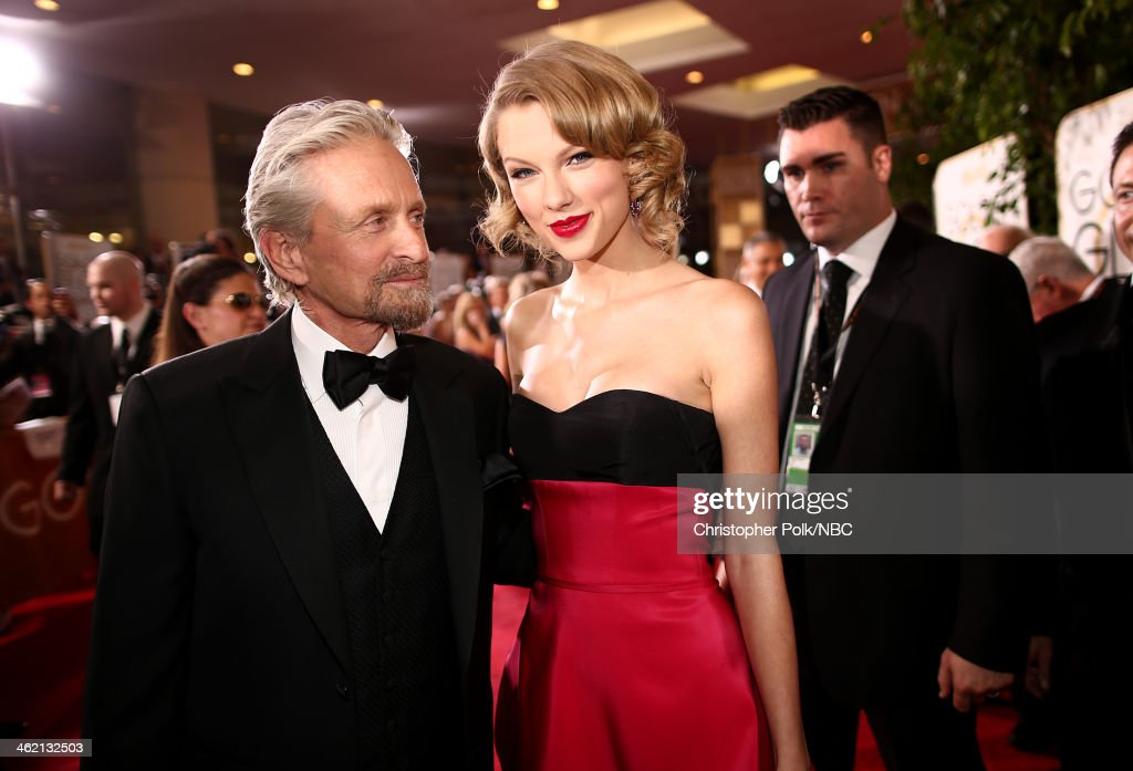 71st ANNUAL GOLDEN GLOBE AWARDS -- Pictured: (l-r) Actor Michael Douglas and recording artist Taylor Swift arrive to the 71st Annual Golden Globe Awards held at the Beverly Hilton Hotel on January 12, 2014 --