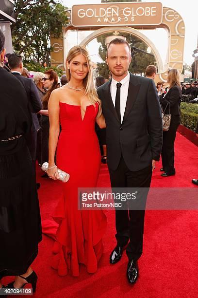 71st ANNUAL GOLDEN GLOBE AWARDS Pictured Actors Lauren Parsekian and Aaron Paul arrive to the 71st Annual Golden Globe Awards held at the Beverly...