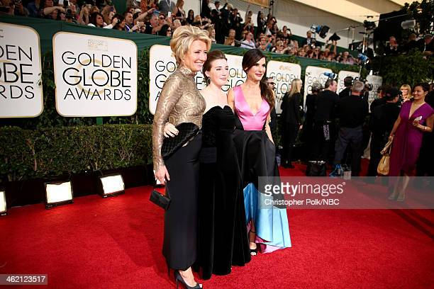 71st ANNUAL GOLDEN GLOBE AWARDS Pictured Actress Emma Thompson daughter Gaia Romilly Wise and actress Sandra Bullock arrive to the 71st Annual Golden...