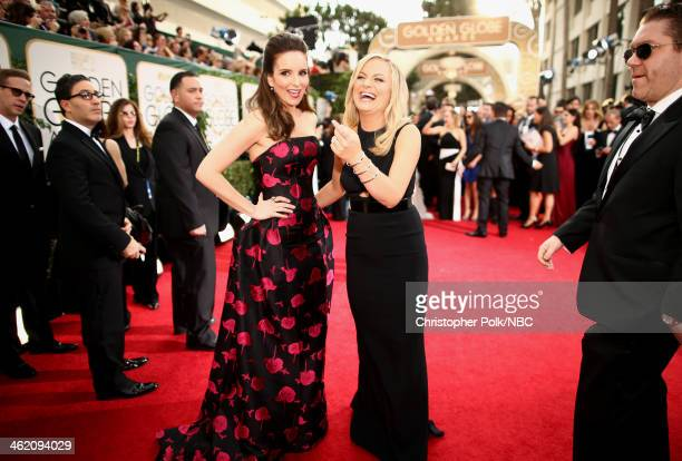 71st ANNUAL GOLDEN GLOBE AWARDS -- Pictured: Actresses Tina Fey and Amy Poehler arrive to the 71st Annual Golden Globe Awards held at the Beverly...