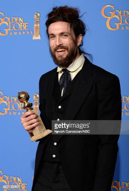 71st ANNUAL GOLDEN GLOBE AWARDS Pictured Musician Alex Ebert winner of Best Original Score for 'All is Lost' poses in the press room at the 71st...
