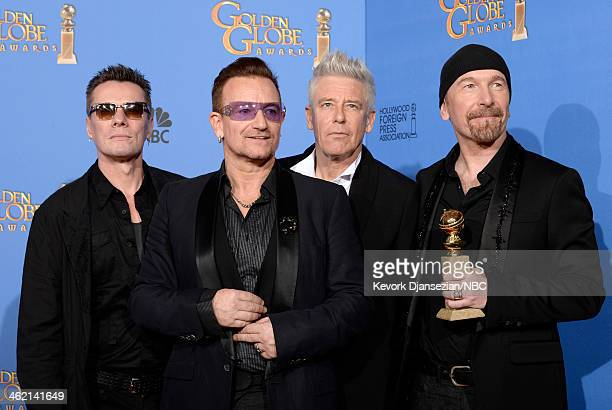 71st ANNUAL GOLDEN GLOBE AWARDS Pictured Musicians Larry Mullen Jr Bono Adam Clayton and The Edge of U2 winners of Best Original Song for 'Ordinary...