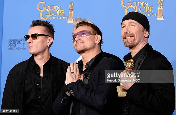 71st ANNUAL GOLDEN GLOBE AWARDS Pictured Musicians Larry Mullen Jr Adam Clayton Bono and The Edge of U2 pose with their award for Best Original Song...