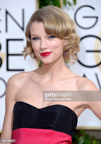 71st ANNUAL GOLDEN GLOBE AWARDS Pictured Recording artist Taylor Swift arrives to the 71st Annual Golden Globe Awards held at the Beverly Hilton...