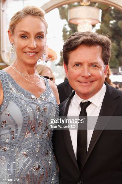 71st ANNUAL GOLDEN GLOBE AWARDS Pictured Tracy Pollan and actor Michael J Fox arrive to the 71st Annual Golden Globe Awards held at the Beverly...