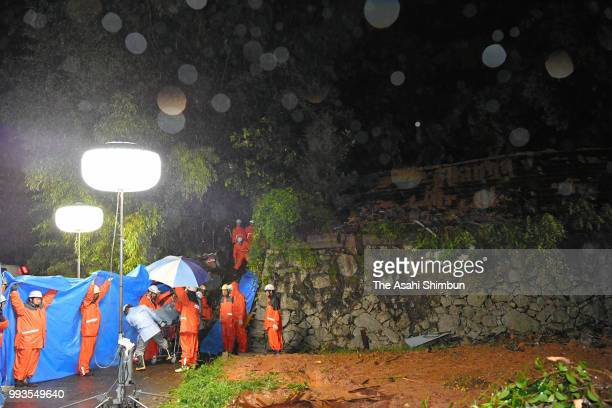 71yearold Eiji Tonohata is rescued 24 hours after a landslide hit his house on July 7 2018 in Higashihiroshima Hiroshima Japan 51 people were killed...