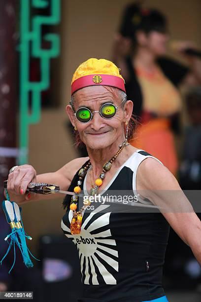 71yearold Li Yinglai dances at Cuihu Park on March 30 2014 in Kunming Yunnan Province of China Li Yinglai began to dress himself as woman at the age...