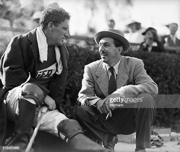 7/20/1938Los Angeles CA Spencer Tracy a player talks to Walt Disney between chukkers of the Fifth Annual Motion Stars Polo Game held recently at Will...