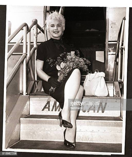 7/20/1958New York New YorkPosing prettily actress Stella Stevens prepares to board a Los Angeles bound plane at La Guardia Airport July 20th The...