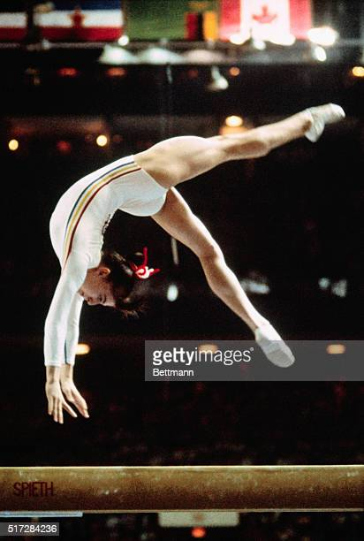 14yearold Nadia Comaneci of Romania whose gymnastics prowess thrust her into the spotlight at Montreal's 1976 Summer Games performs a back handspring...