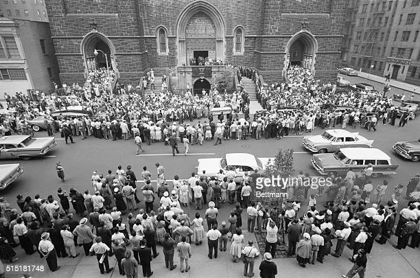 7/21/1959New York NY Crowds mill around St Paul the Apostle Roman Catholic Church as the casket of blues singer Billie Holiday is brought out...