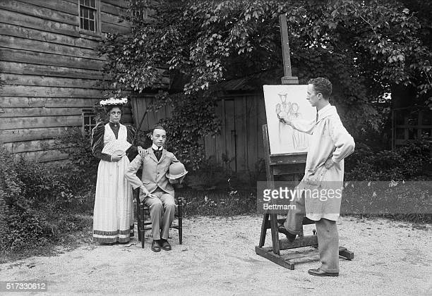 New Rochelle, New York: Norman Rockwell, modern artist, drawing modern models in his home at New Rochelle.