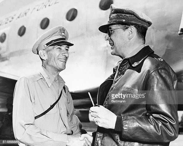 Brig General John Church Chief of GHQ advanced Echelon in Korea welcomes General of the Army Douglas MacArthur Supreme Allied Commander on his...