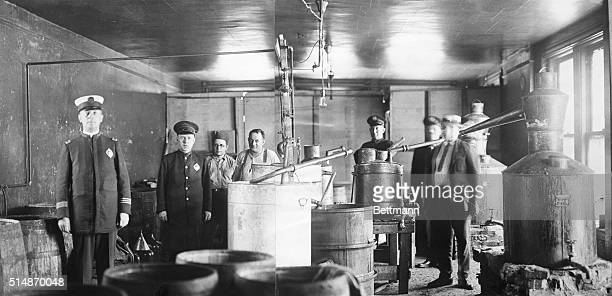 7/22/1922Pittsburgh PA A view of the giant moonshine still taken by the police during a raid a in downtown Pittsburgh business building Two of the...