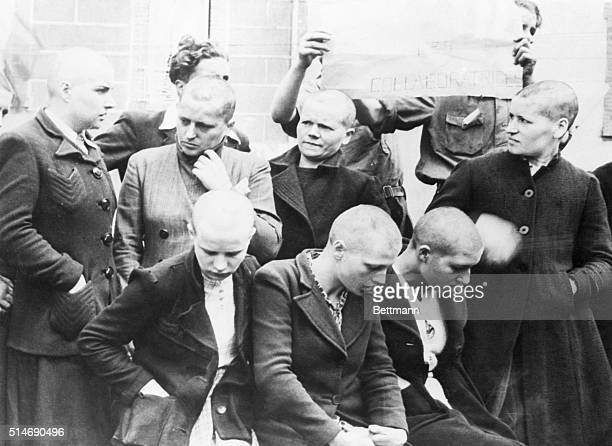 A group of French women who collaborated with the Nazis are shown here after having been rounded up the morning of Bastille Day They were shorn of...