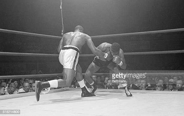 Las Vegas, Nevada- World heavyweight champion Sonny Liston lands blow to the jaw of the challenger Floyd Patterson during the title fight here 7/22....