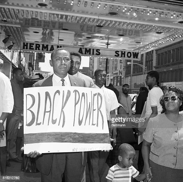 7/22/1966New York NY Floyd B McKissick national director of the Congress of Racial Equality carries a sign reading Black Power after joining a picket...
