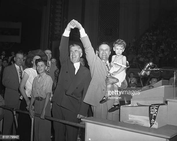 7/24/1948Philadelphia PAHenry A Wallace and his running mateSen Glen Taylor of Idaho the latter holding twoyearold son Gregorytake bows from rostrum...