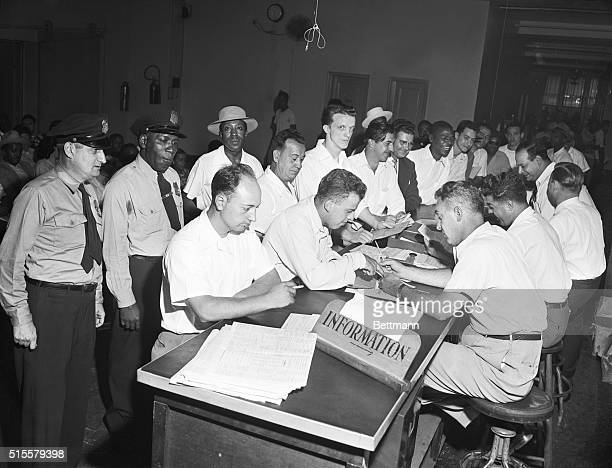 New York, NY: Last day rush for GI bill educational courses at New York regional office Veterans Administration- 252 7th Avenue. Photo shows crowd of...