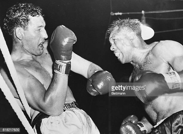 Toronto, Canada- Archie Moore is about to unleash an attack, as James J. Parker covers up while caught on the ropes, during their heavyweight bout,...