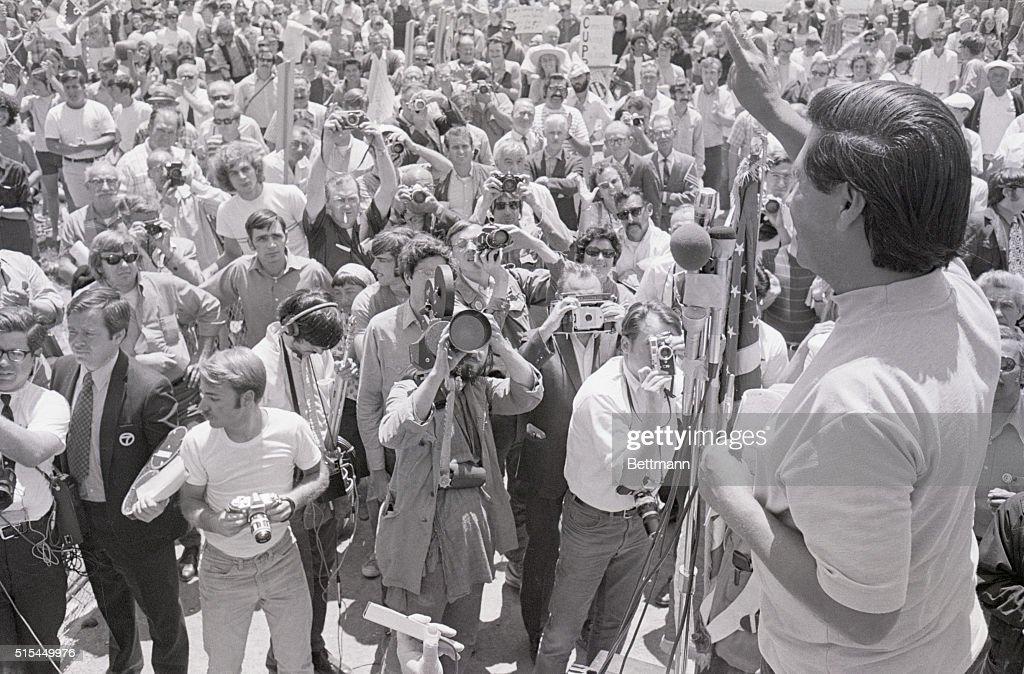 Cesar Chavez Gives Crowd Peace Sign : News Photo