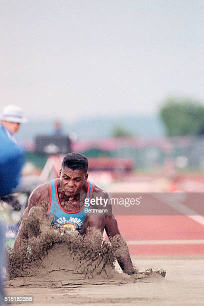 "Seattle, WA- Carl Lewis touches down at 27'6"" to win the gold medal in the long jump competition of the Goodwill Games. Lewis has a nine year winning..."