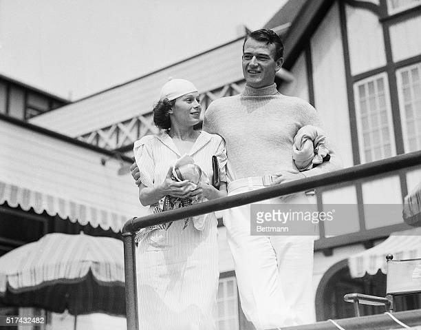 7/26/1933Santa Monica CA Mr and Mrs John Wayne who were recently married are shown at the exclusive Santa Monica swimming club where many of the...