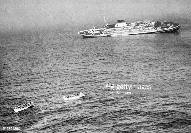 7/26/1956Boston MA Three lifeboats loaded to the gunwales pull away from the 29000ton Italian Luxery Liner Andrea Doria this mourning as the huge...