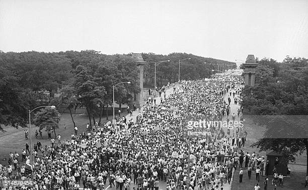 Thousands of civil rights marchers led by Dr Martin Luther King walk toward Chicago's city hall in protest of defacto school segregation and other...