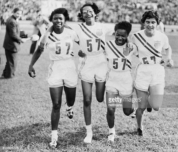 Helsinki, Finland- Members of the U.S. Women's 400 meter relay team cavort on the field after winning the event on the last day of the track and...