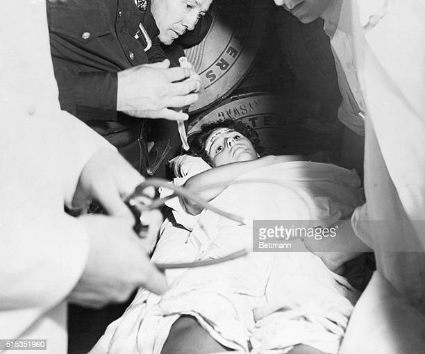 7/27/1956New York NY Linda Morgan one of the more than 500 survivors of the Andrea Doria who arrived in New York today is shown on a stretcher after...